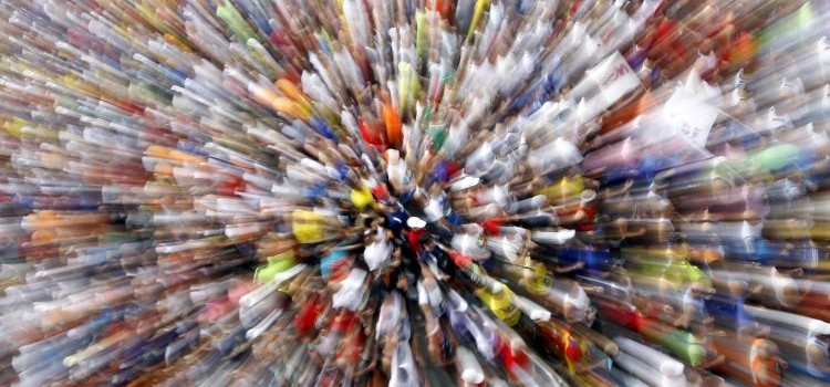 Competitors take part in a marathon in front of the Colosseum in Rome